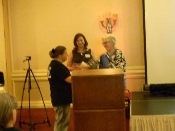 Pat presented gift by Lisa Peck